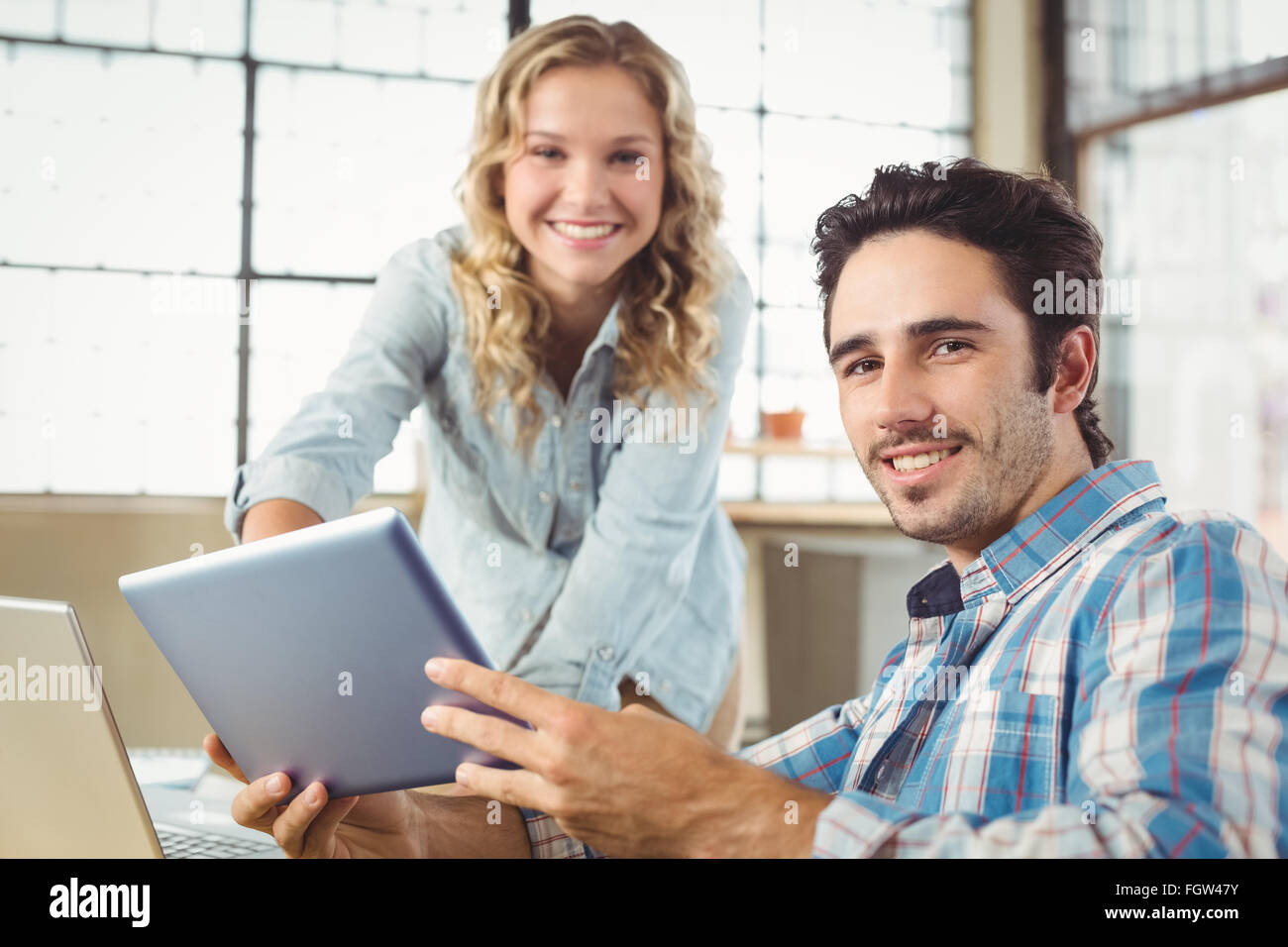 Portrait of business people working at office - Stock Image