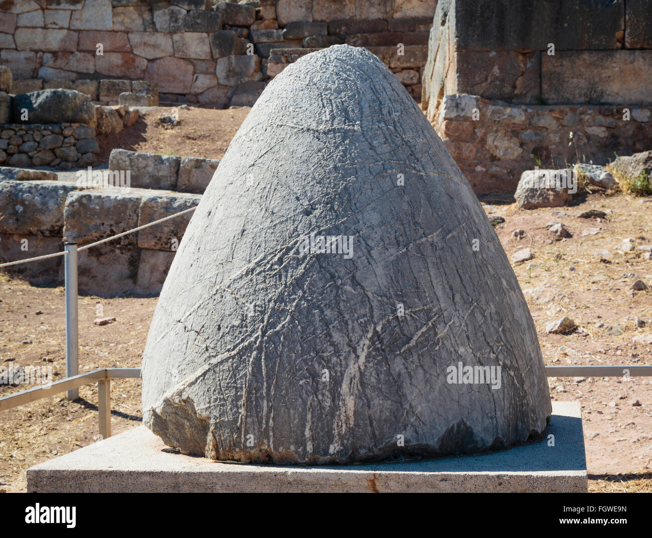 Ancient Delphi, Phocis, Greece.  The omphalos, or navel, of ancient Delphi. Stock Photo