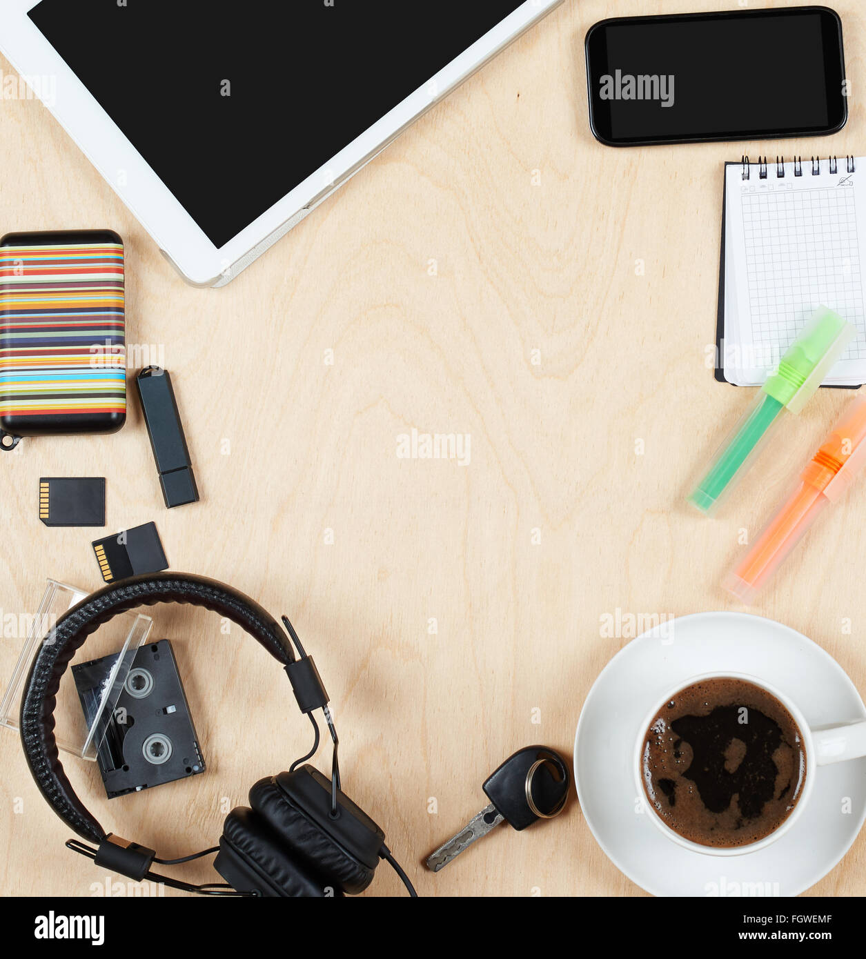 Flat lay office tools and supplies, tablet computer,cards, coffee and other stuff. Flat design and top view on desk Stock Photo