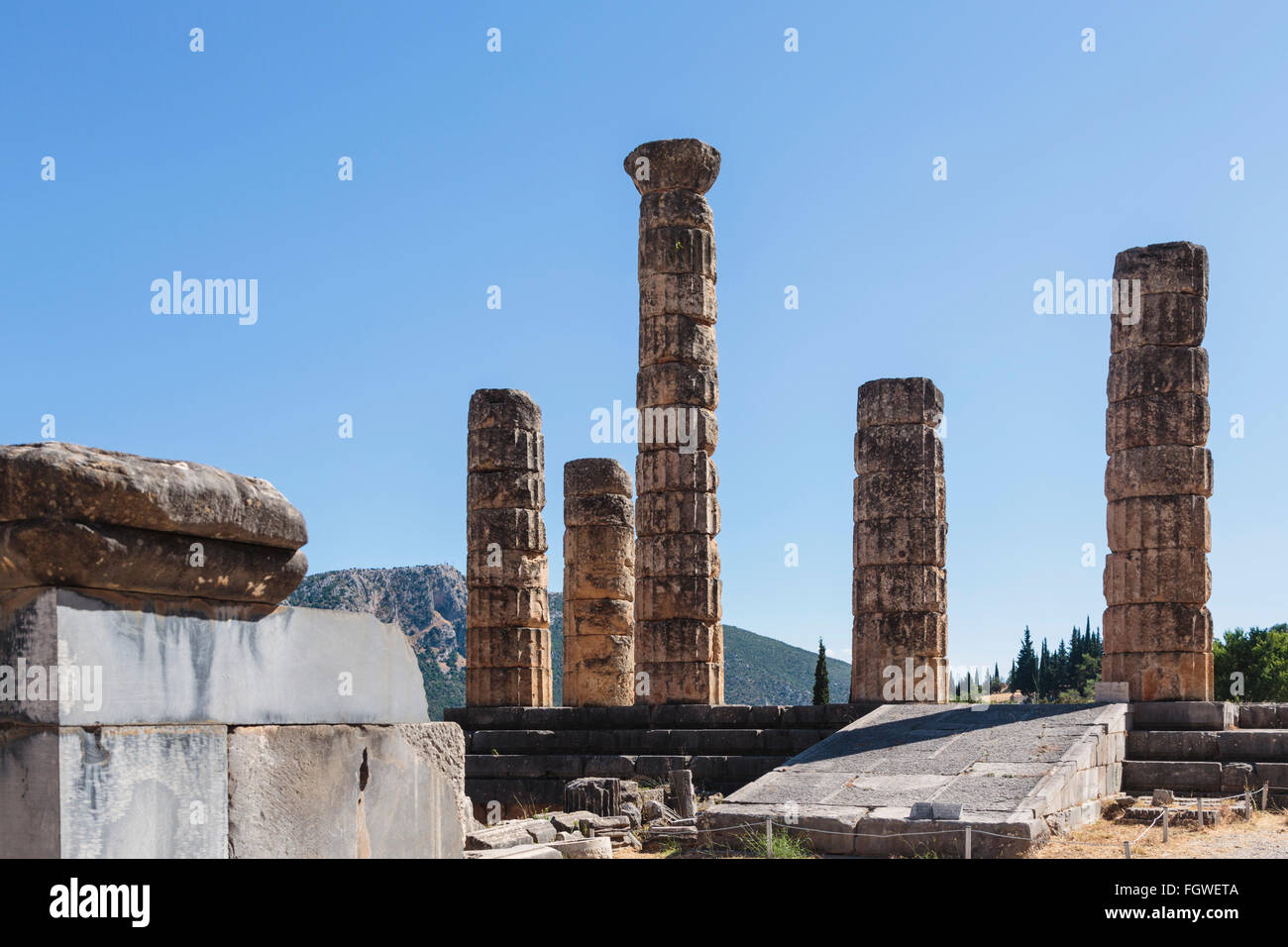 Ancient Delphi, Phocis, Greece.  Remains of the Temple of Apollo.  Today's visible ruins date from the 4th century Stock Photo