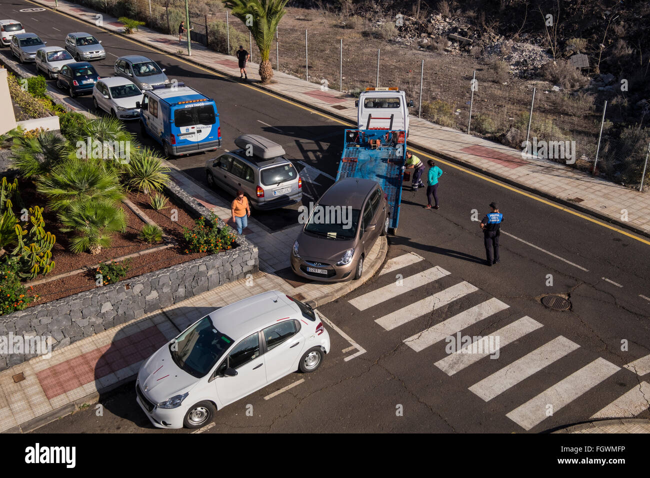 Illegally parked car being towed away. Playa San Juan, Tenerife, Canary Islands, Spain - Stock Image