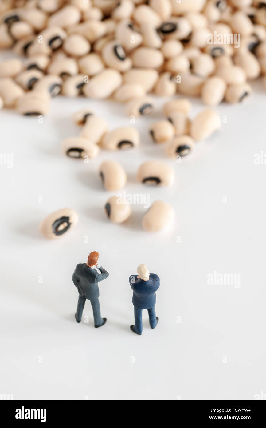 Over zealous corporate bean counters a financial or business concept with copy space - Stock Image
