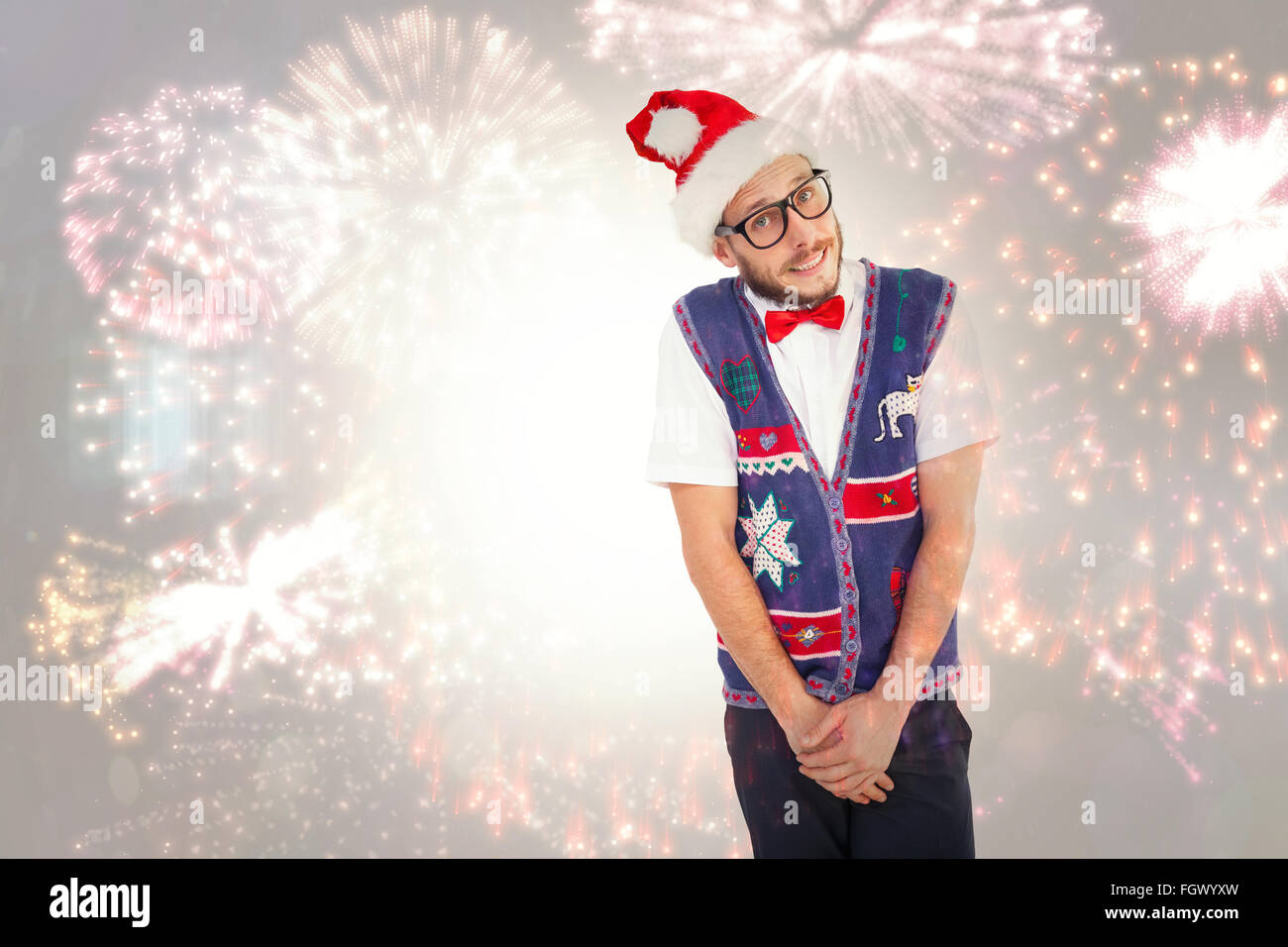 Composite image of geeky hipster in santa hat - Stock Image