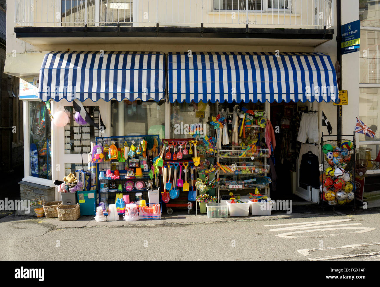 A traditional British seaside shop selling buckets and spades, beach toys, postcards and souvenirs - Stock Image