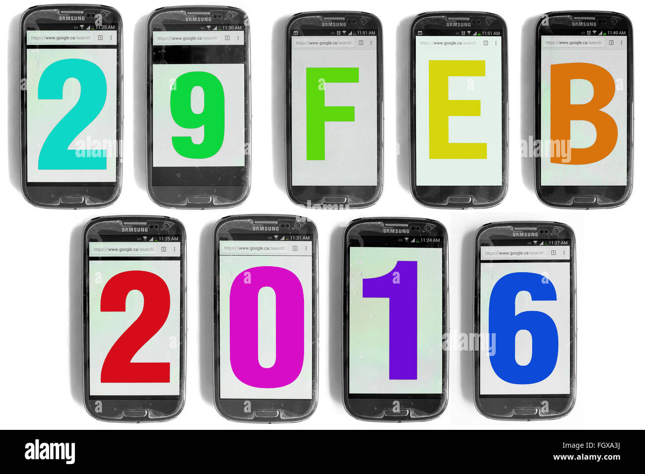 29 Feb written on the screens of smartphones photographed against a white background. - Stock Image