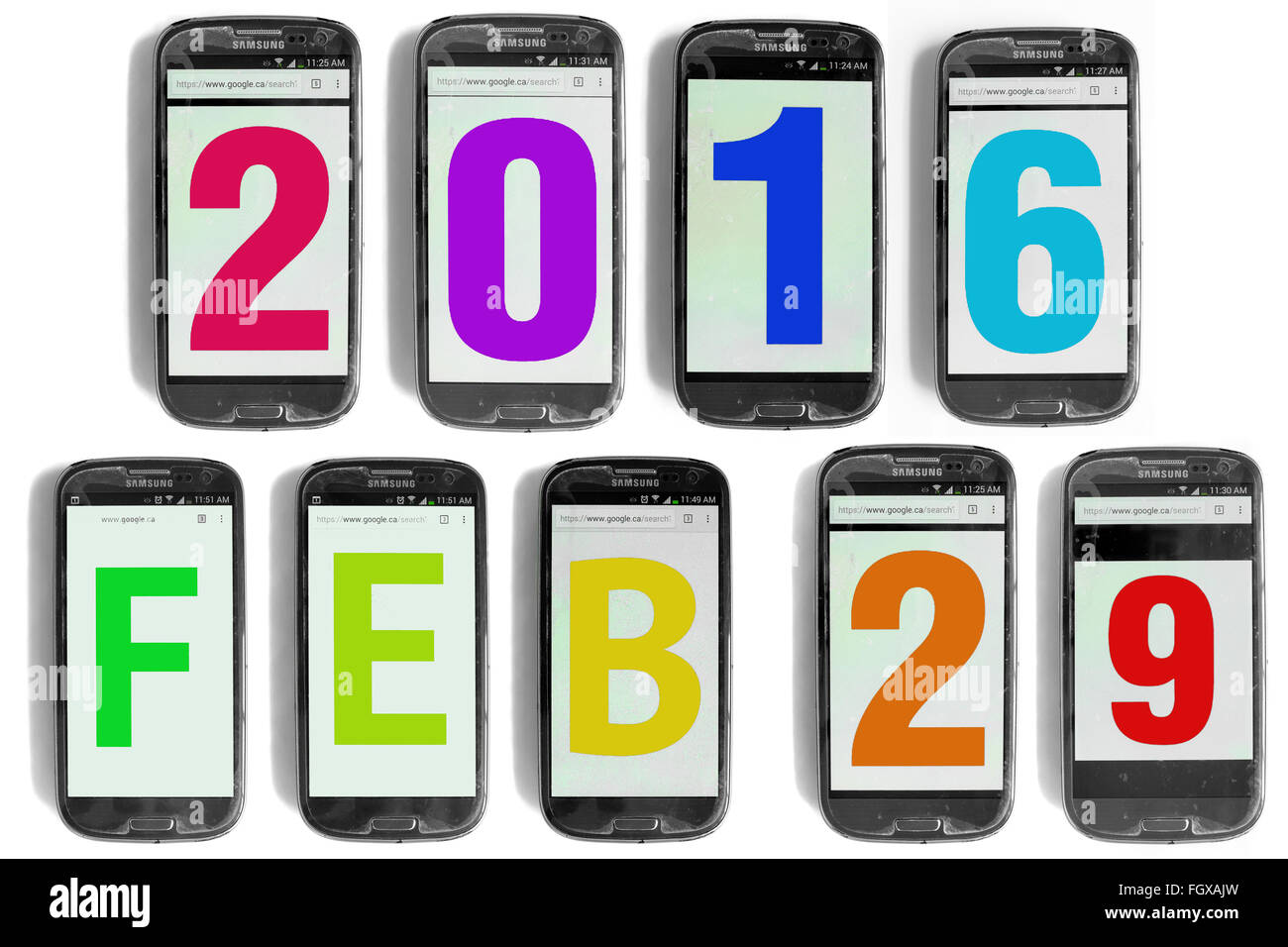 2016 Feb 29 written on the screens of smartphones photographed against a white background. - Stock Image
