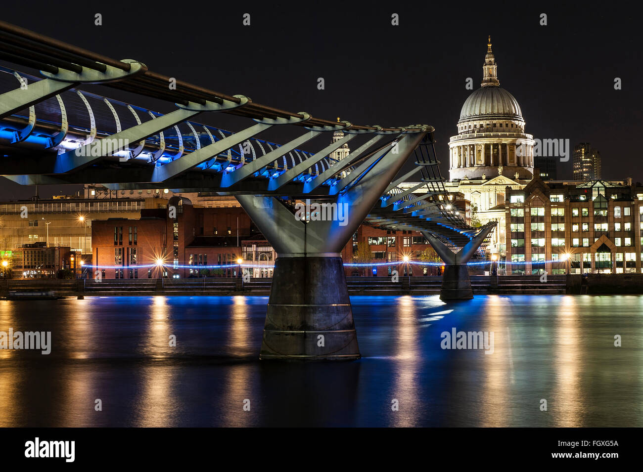 St. Paul Cathedral and Millennium Bridge in London - Stock Image