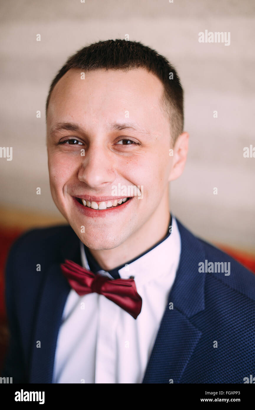 Groom is preparing for his wedding in the morning - Stock Image