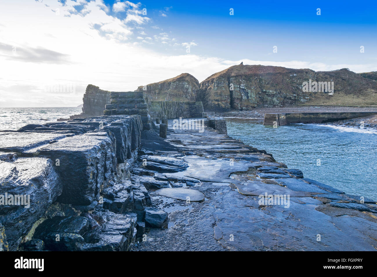 LATHERONWHEEL HARBOUR CAITHNESS SCOTLAND WINDSWEPT RUGGED HARBOUR AND COVE - Stock Image