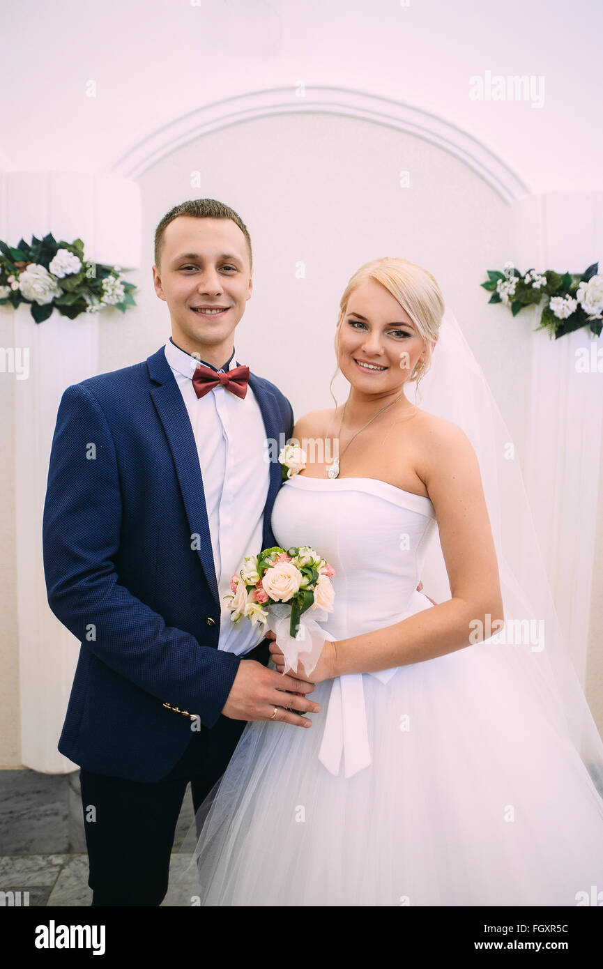 Bride and groom on marriage registration. The groom looks at the bride. Newlyweds at the wedding ceremony. - Stock Image