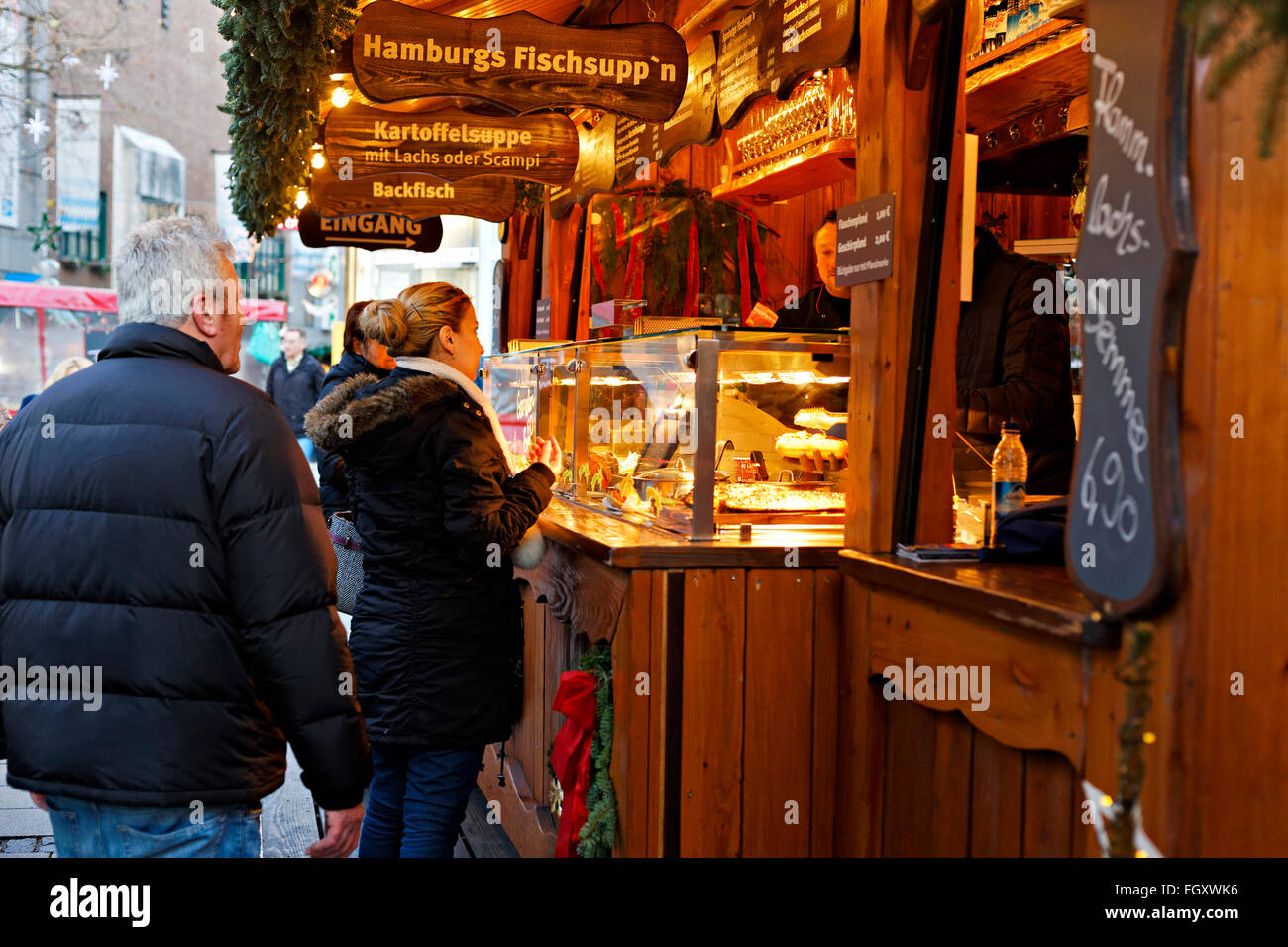 Traditional food stand, at the German Christmas markets, Munich, Upper Bavaria, Germany, Europe. - Stock Image