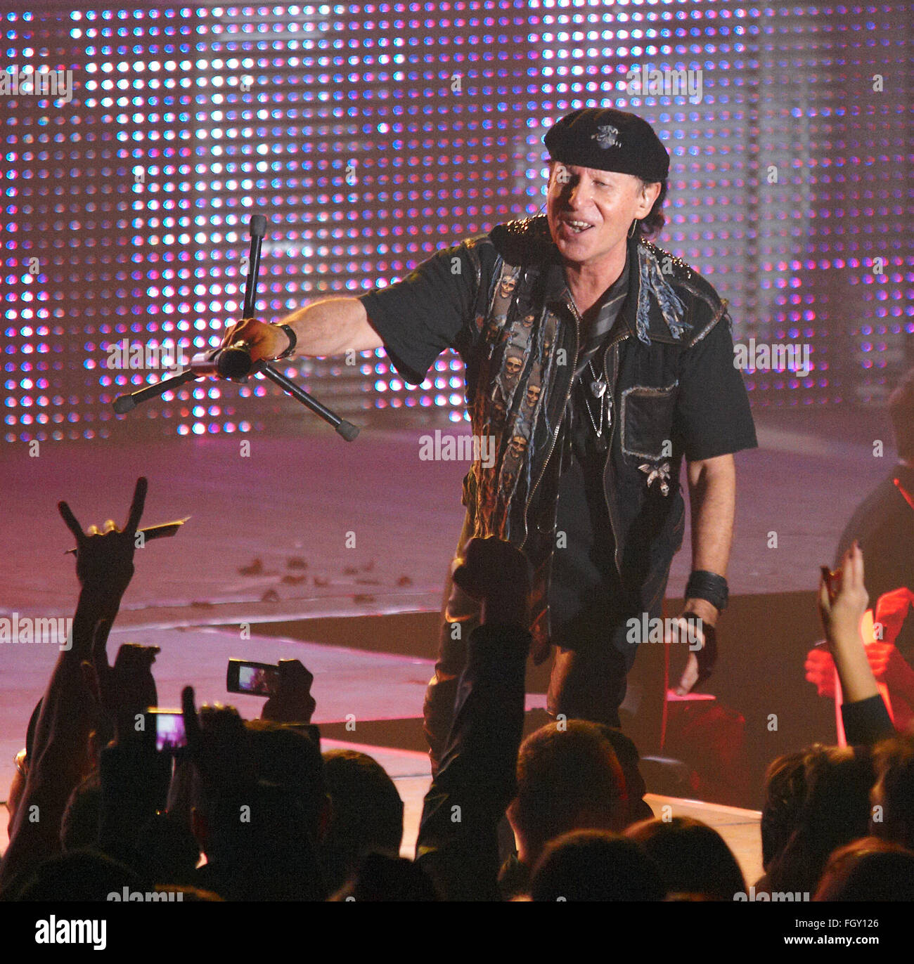 DNIPROPETROVSK, UKRAINE - OCTOBER 31, 2012: Vocalist of the Scorpions band Klaus Meine with microphone on the stage - Stock Image