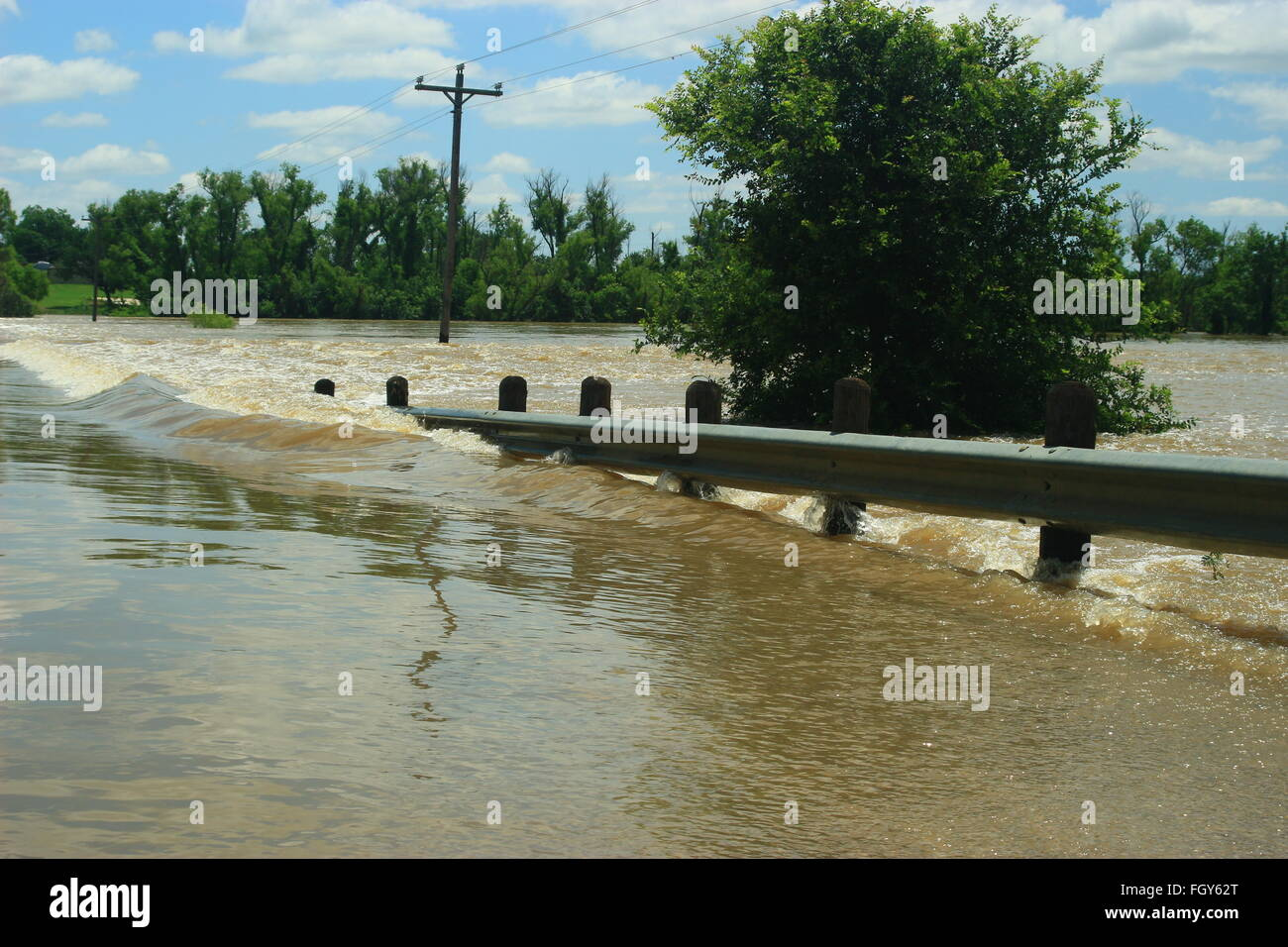 County Road 4668 near Boyd, Texas, is closed as water from Bridgeport Lake flows over the roadway flooding thousands Stock Photo