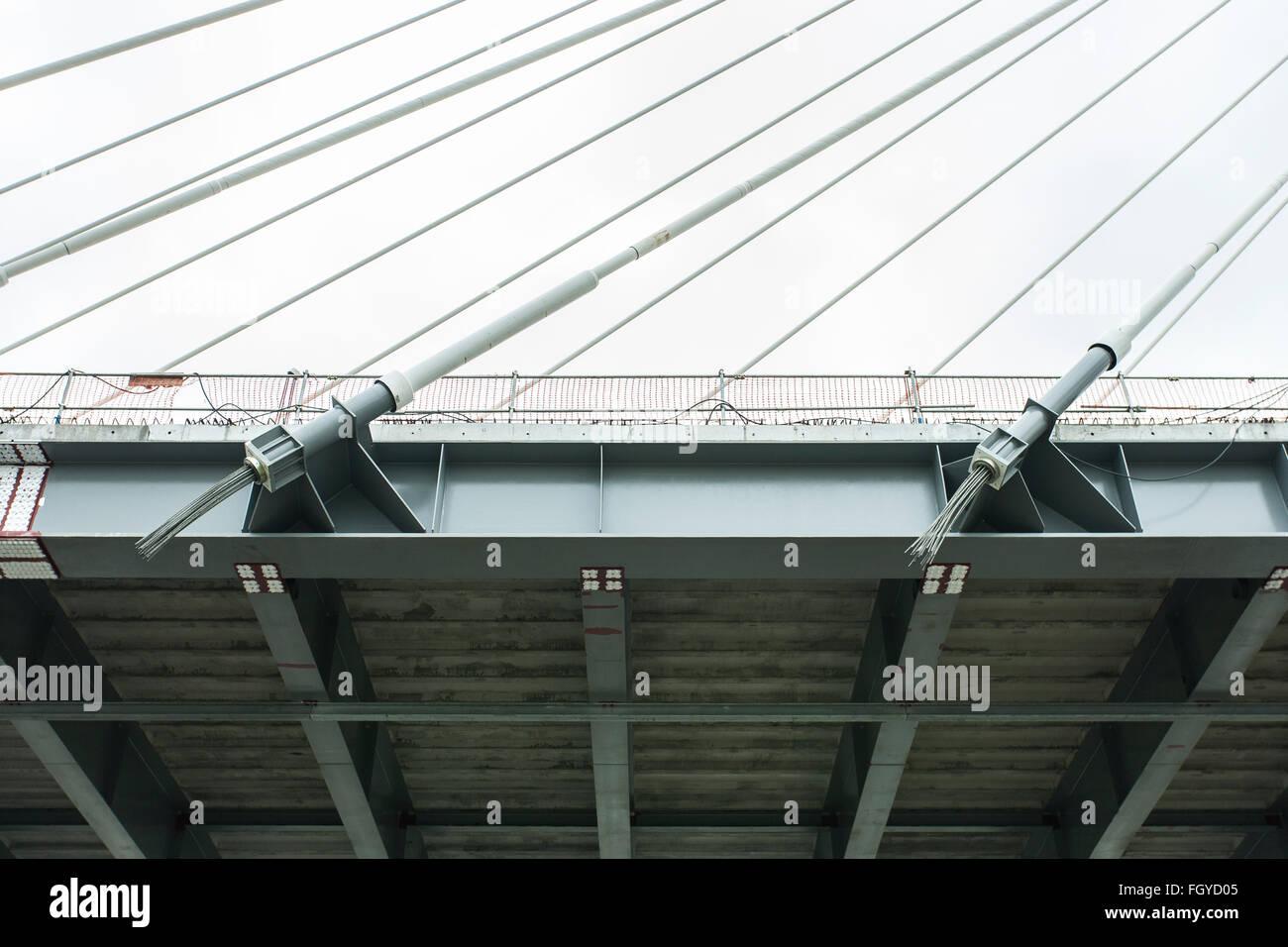 cable suspension bridge under construction river uk - Stock Image