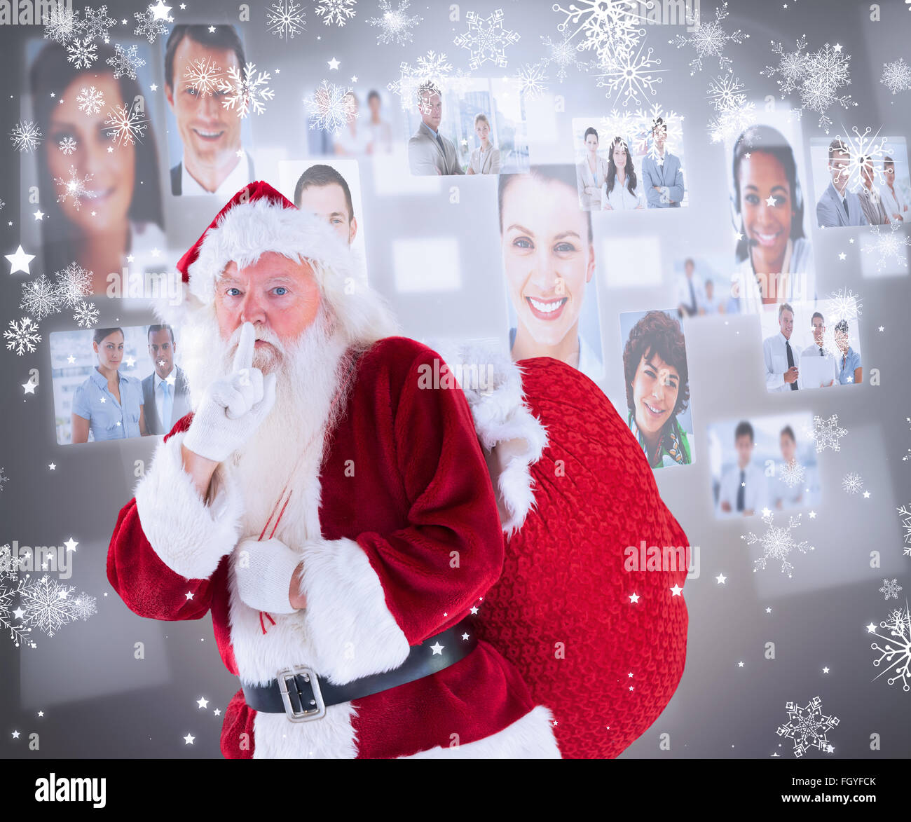 Composite image of santa asking for quiet with bag - Stock Image