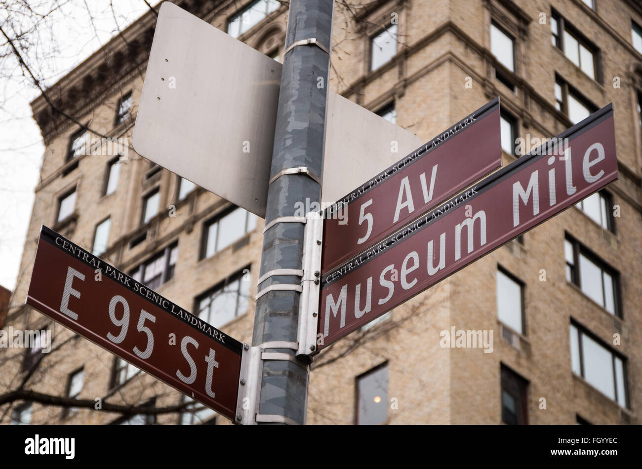 Street signpost in New York, with 5th Avenue, Museum Mile and East 95th Street on it. - Stock Image