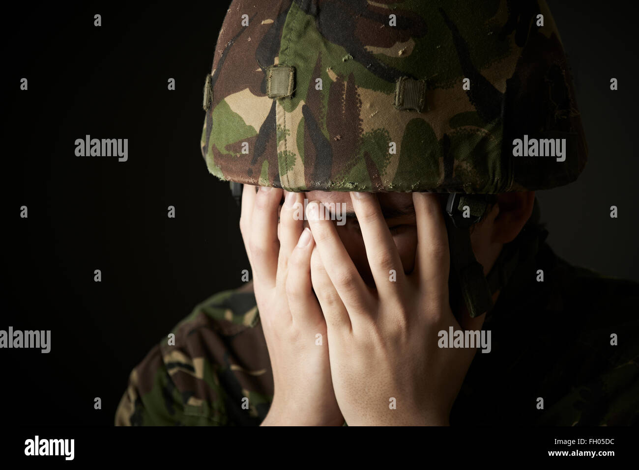 Soldier In Uniform Suffering From Stress - Stock Image