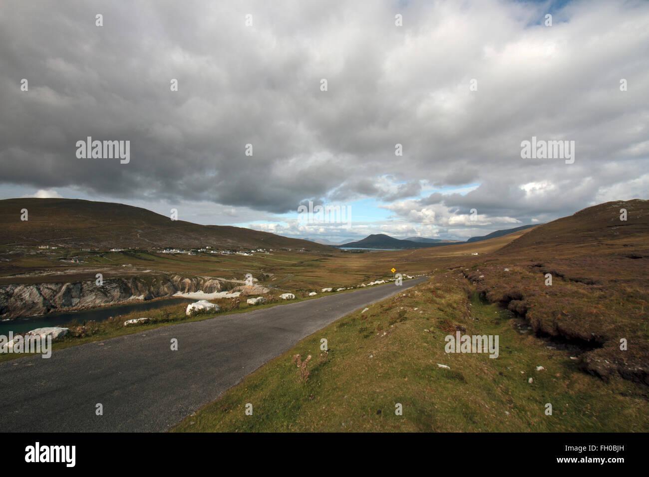 Road, Sea and Cliffs, Achill Island, Co. Mayo, Republic of Ireland - Stock Image