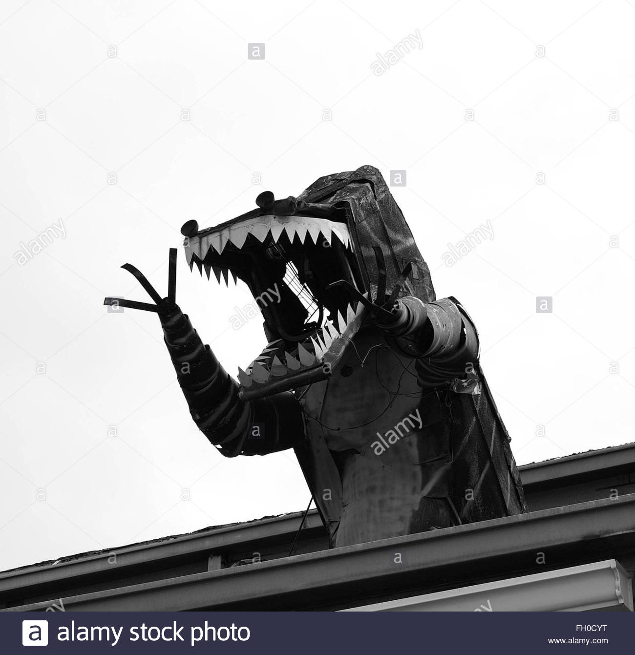 A tin model of a dinosaur or monster - Stock Image