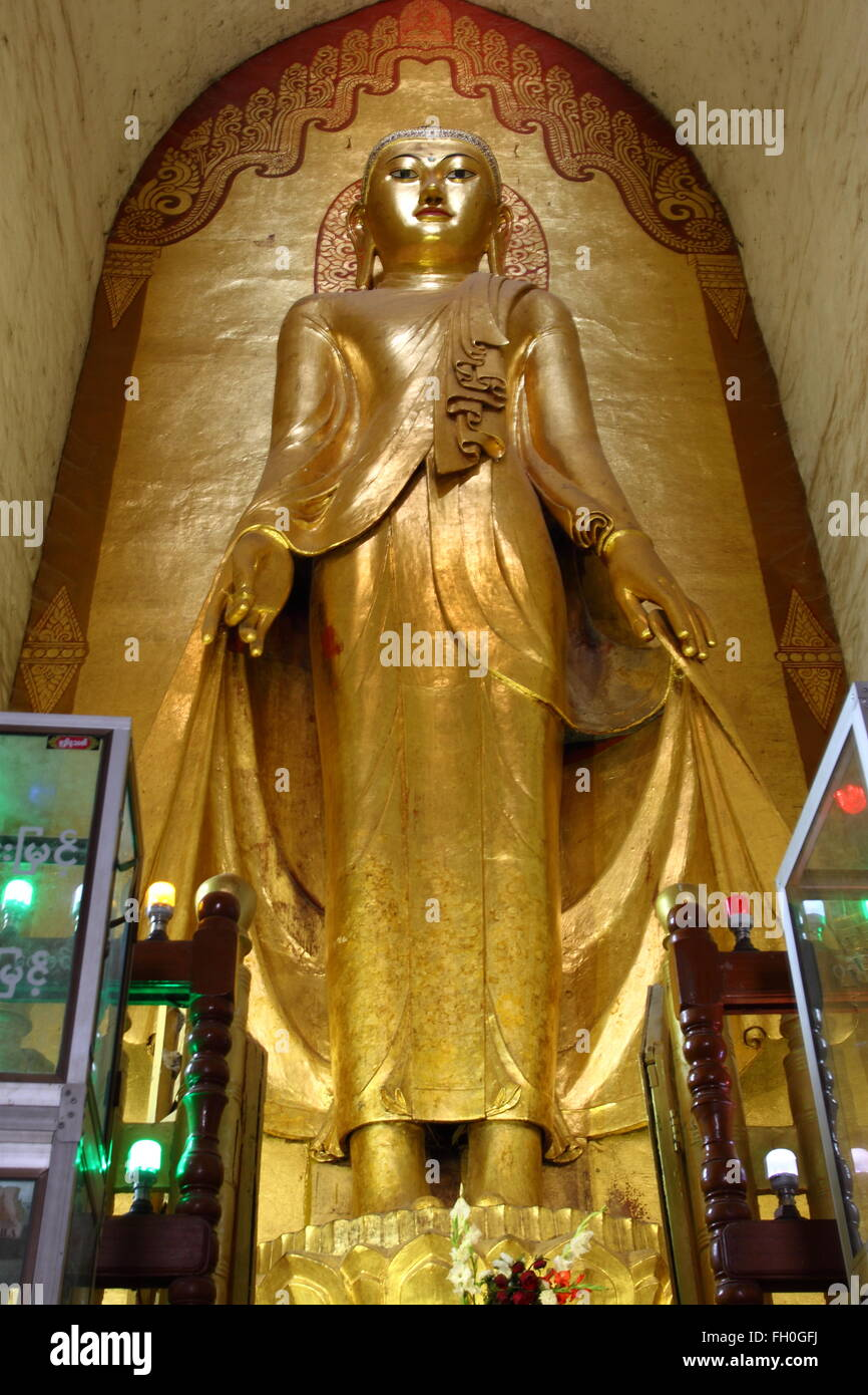 Ananda, The old golden Buddha statue in pagoda temple in Bagan,Myanmar Stock Photo