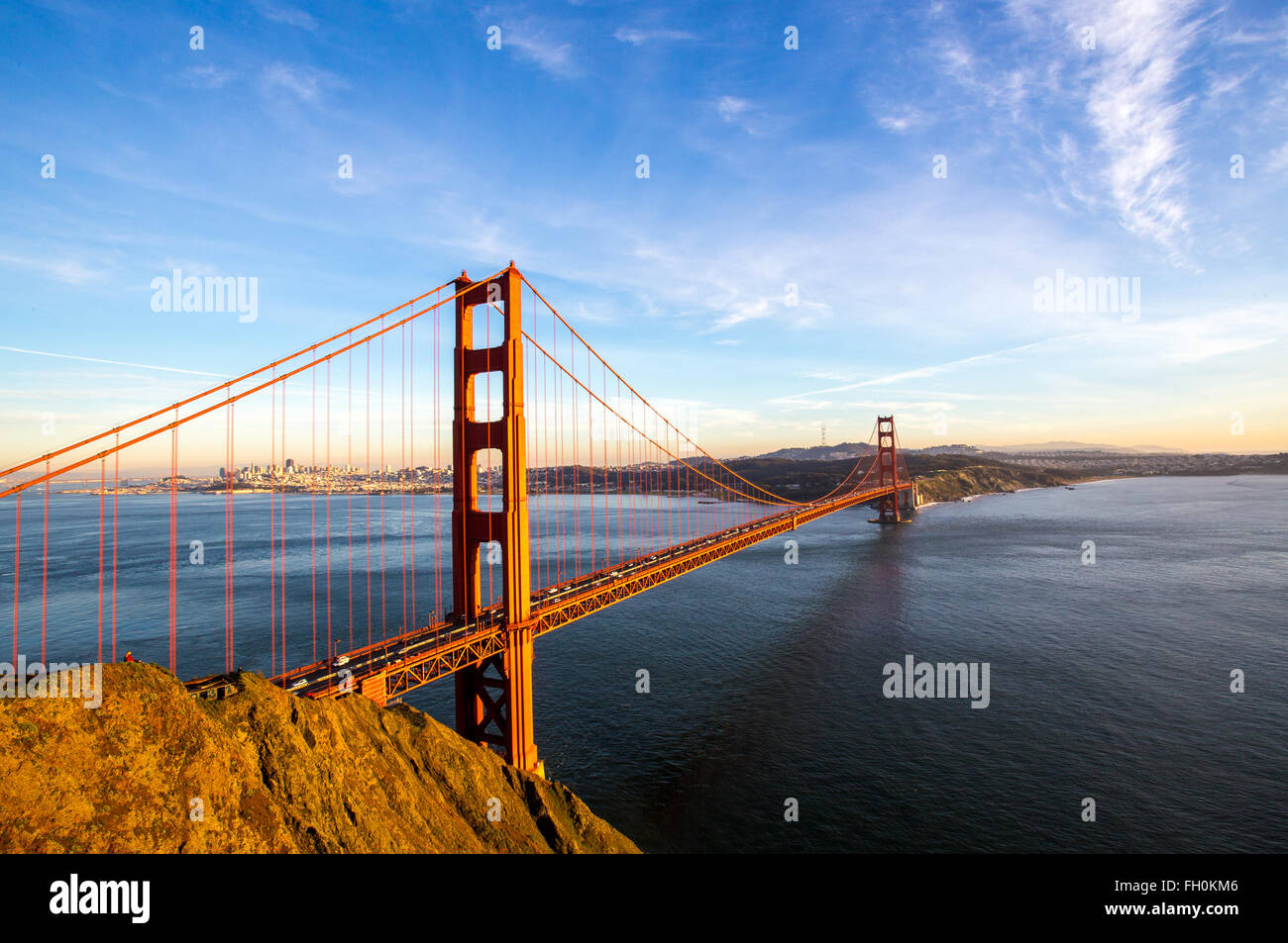 Sunny blue skies over the San Francisco skyline with the iconic Golden Gate Bridge - Stock Image