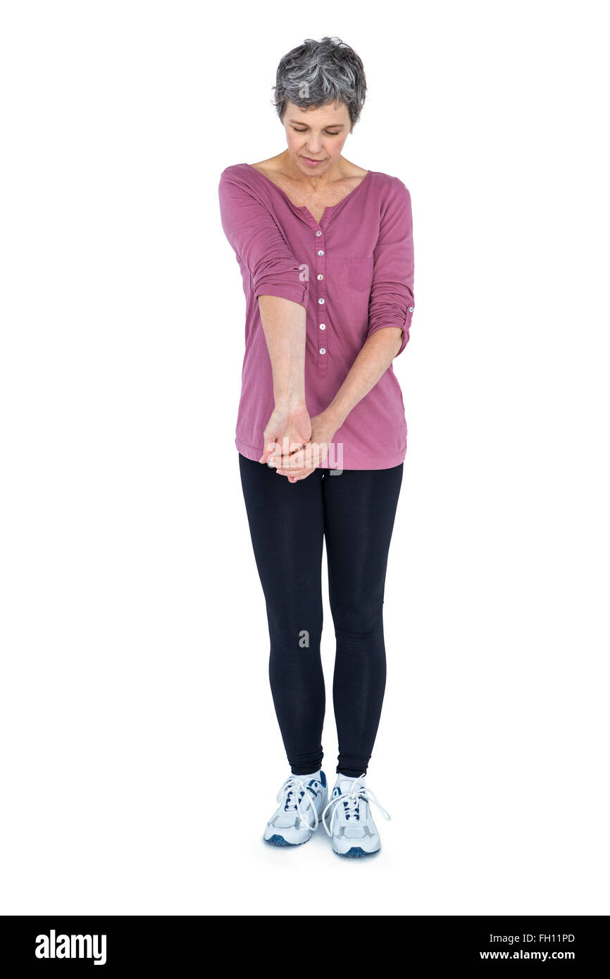 Mature woman stretching - Stock Image