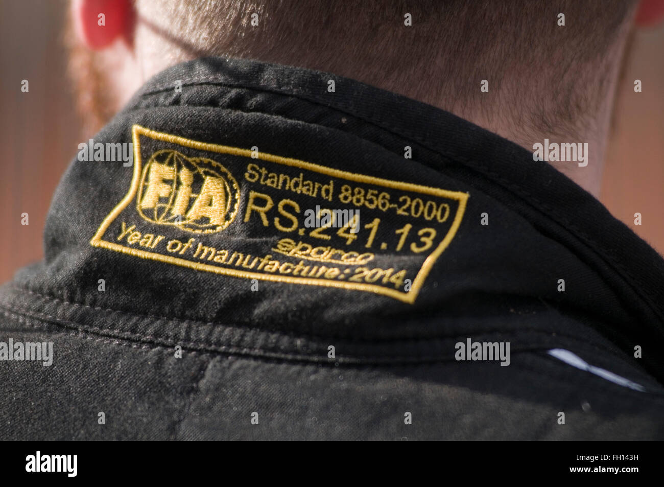 FIA approved fire suit being worn by racing driver safety standard standards fireproof proof overall overalls racing - Stock Image