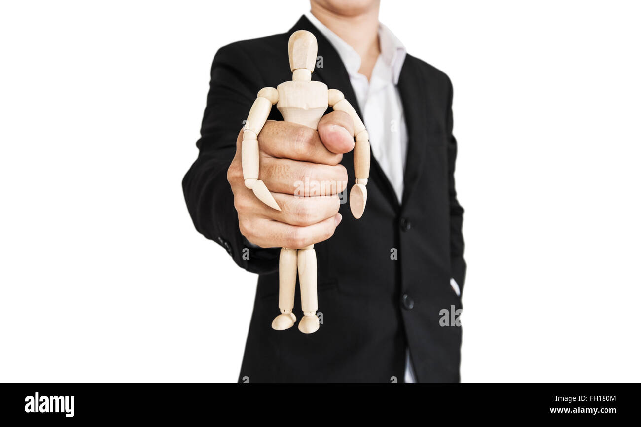 Businessman holding wooden figure, concept of take control, oppress, and etc., isolated on white background - Stock Image
