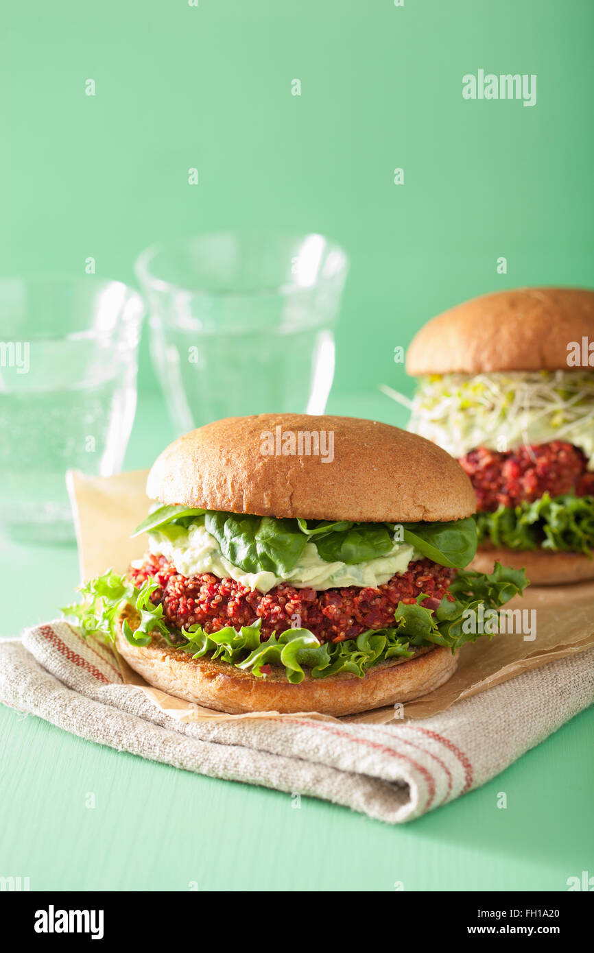 veggie beet and quinoa burger with avocado dressing - Stock Image