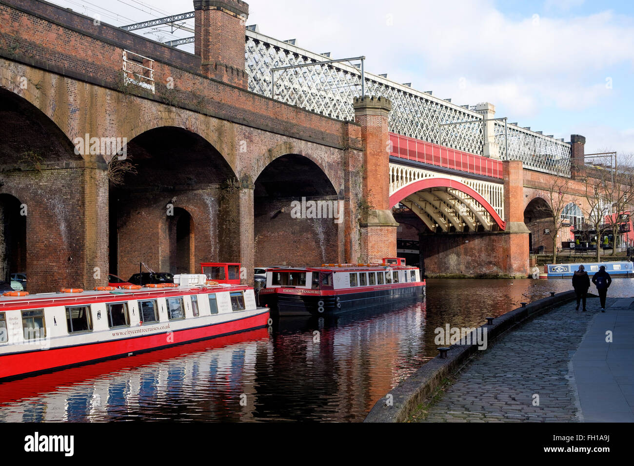 Manchester, UK - 15 February 2016: Victorian railway viaducts of the Castlefield viaduct above the Bridgewater Canal, - Stock Image