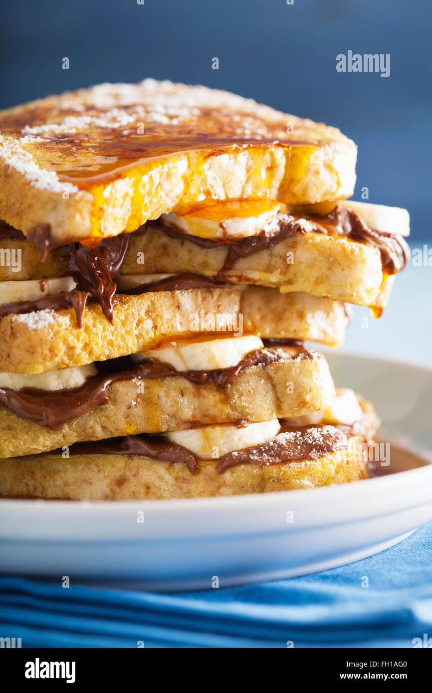 french toasts with banana chocolate sauce and caramel for breakfast - Stock Image