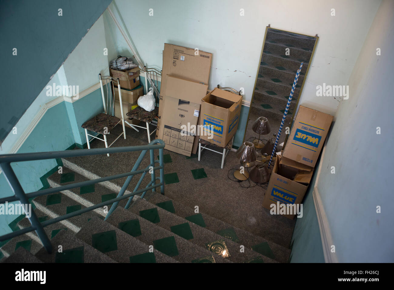 Old furniture and clutter causing an obstruction to the fire exit of a budget Hotel in the Philippines. - Stock Image