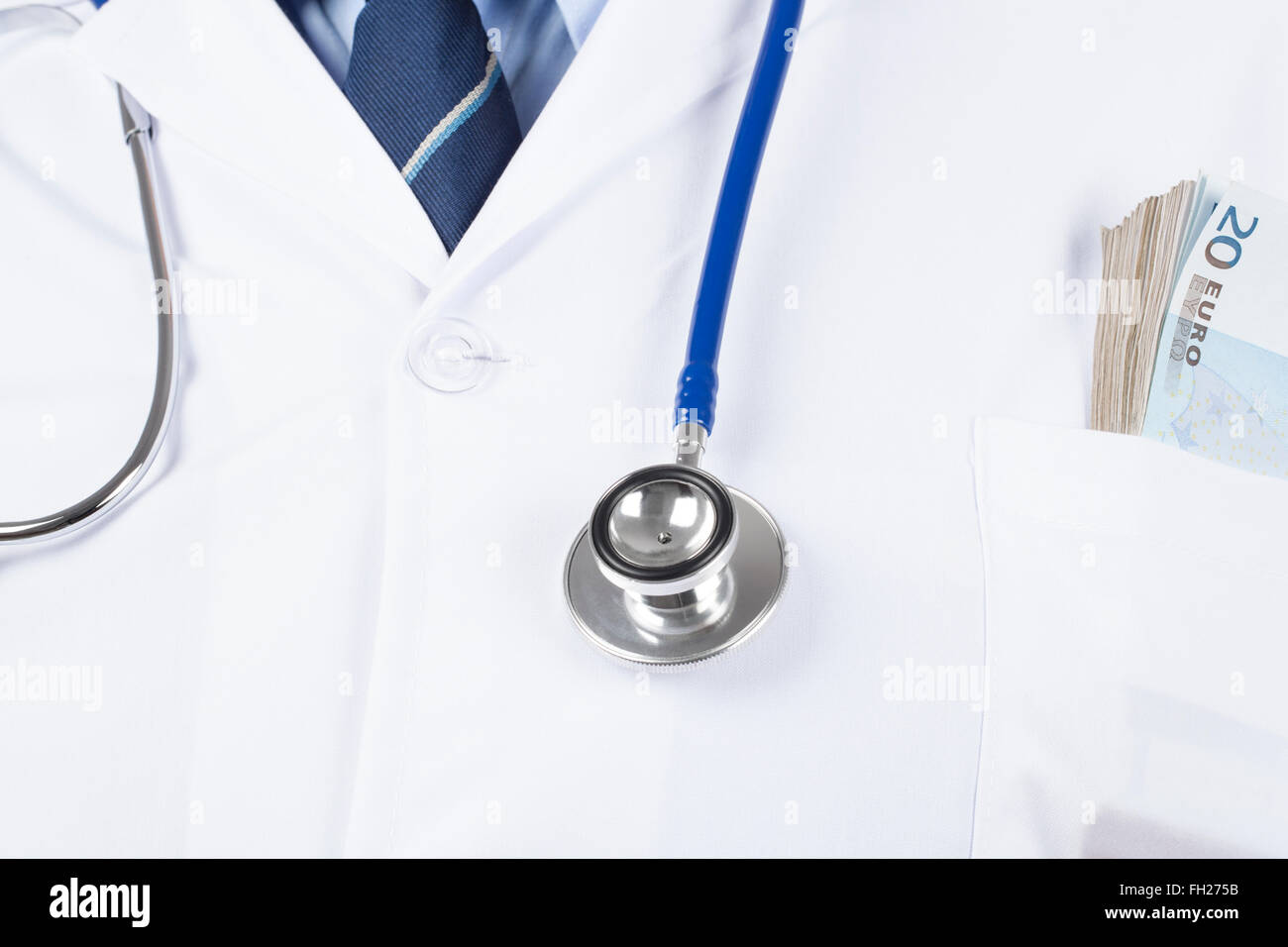 Doctor in white tunic with stethoscope and wad of money in the pocket. - Stock Image