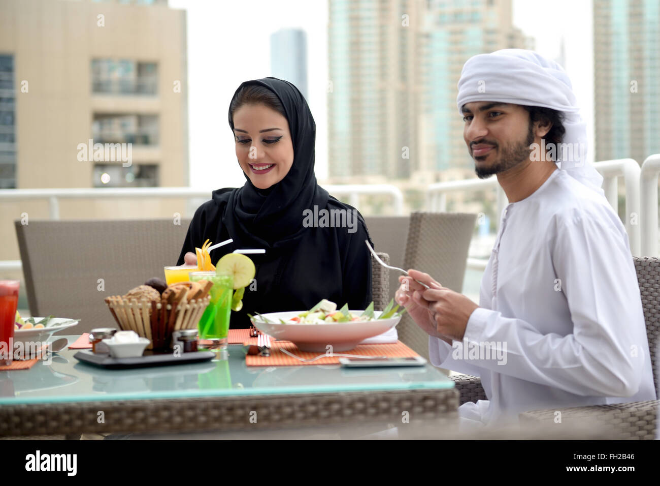 Young Emirati arab couple dining - Stock Image