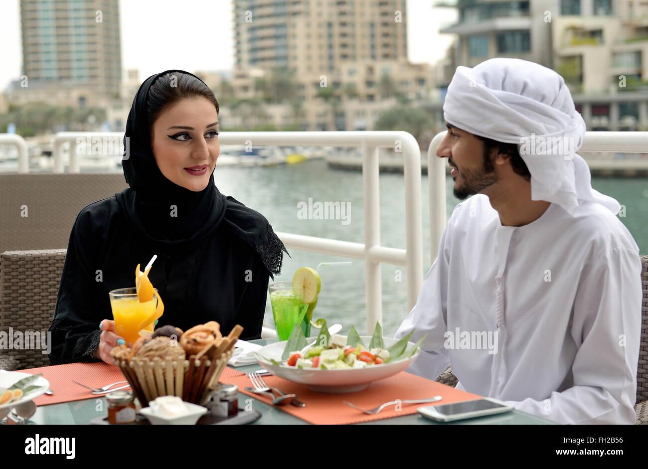 Young Emirati arab couple dining Stock Photo
