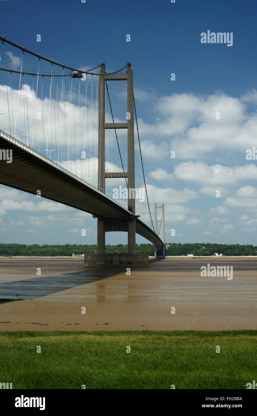 Humber Bridge in portrait format looking North from South bank of the River Humber - Stock Image