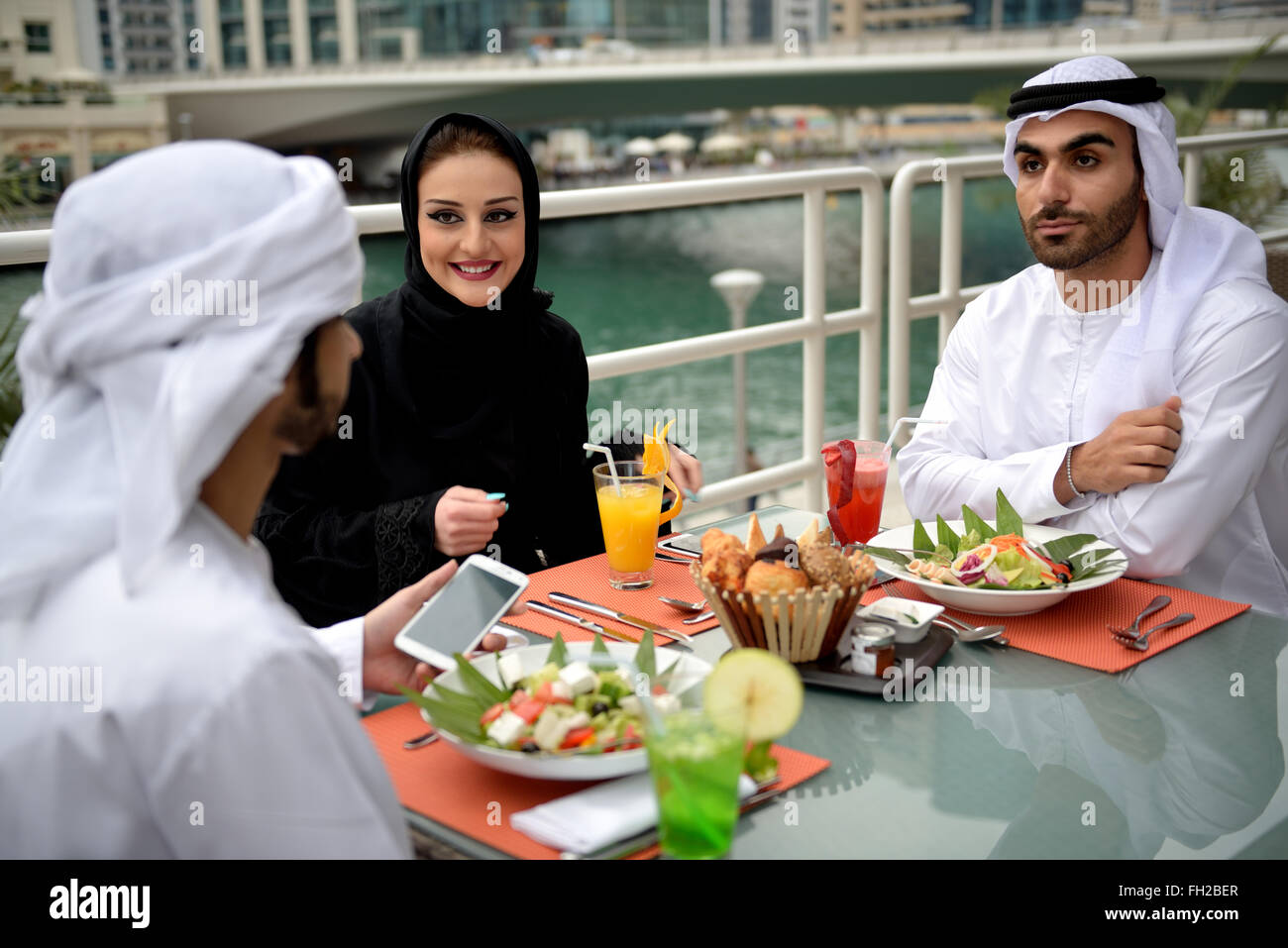 Young Emirati arab friends dining in a restaurant Stock Photo