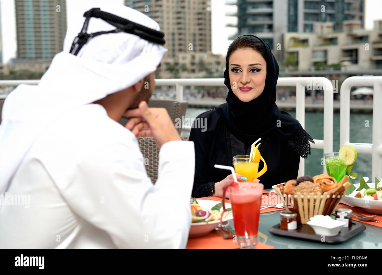 Young Emirati arab couple dining at a restaurant Stock Photo