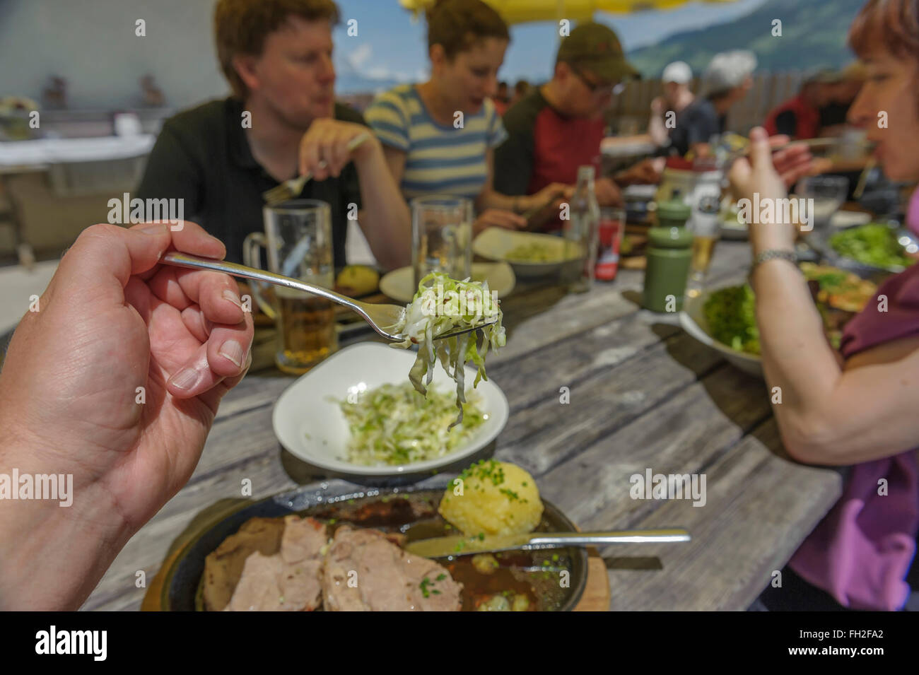 Hikers enjoying a lunchtime meal at a mountain hut. Kitzbüheler Alps. Kitzbühel, Austria. Europe Stock Photo