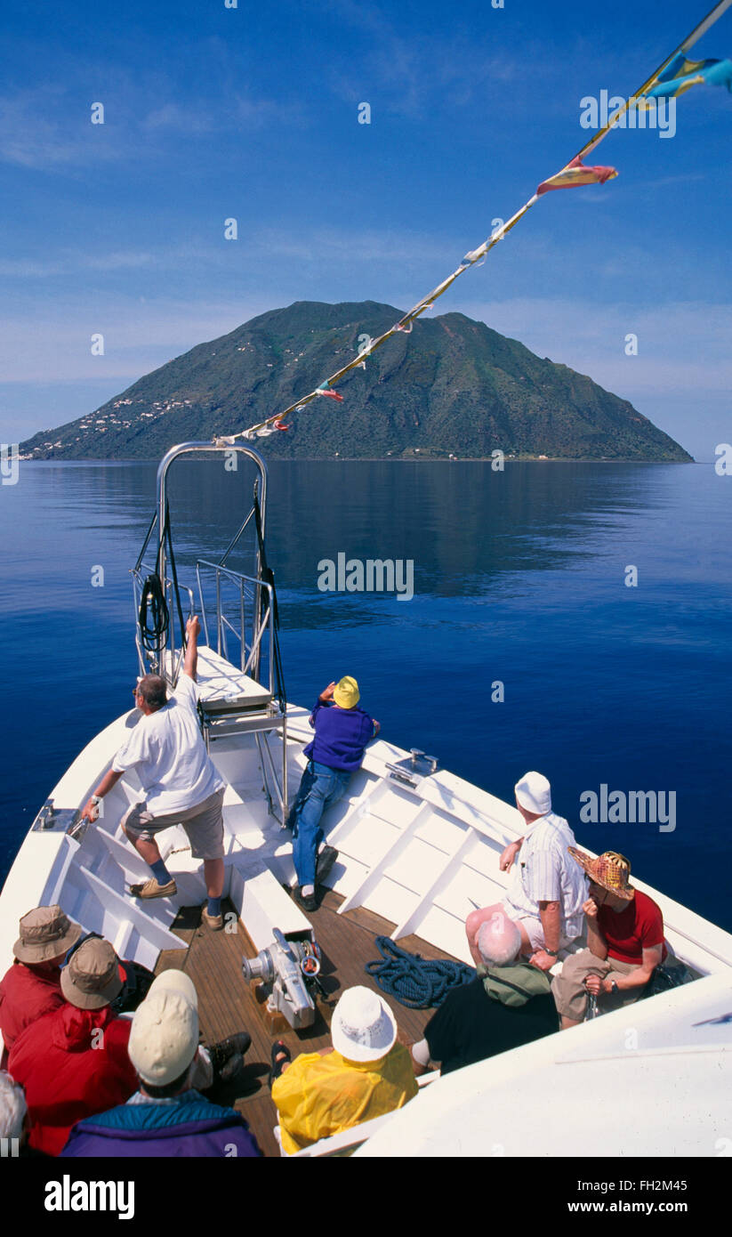 Tourist cruise ship near Salina island, Aeolian Islands, Sicily, Italy, Europe - Stock Image