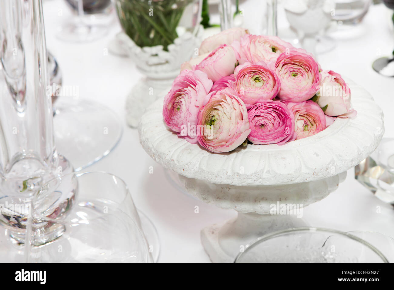 decoration of wedding table. pink ranunculus (persian buttercup) in ...