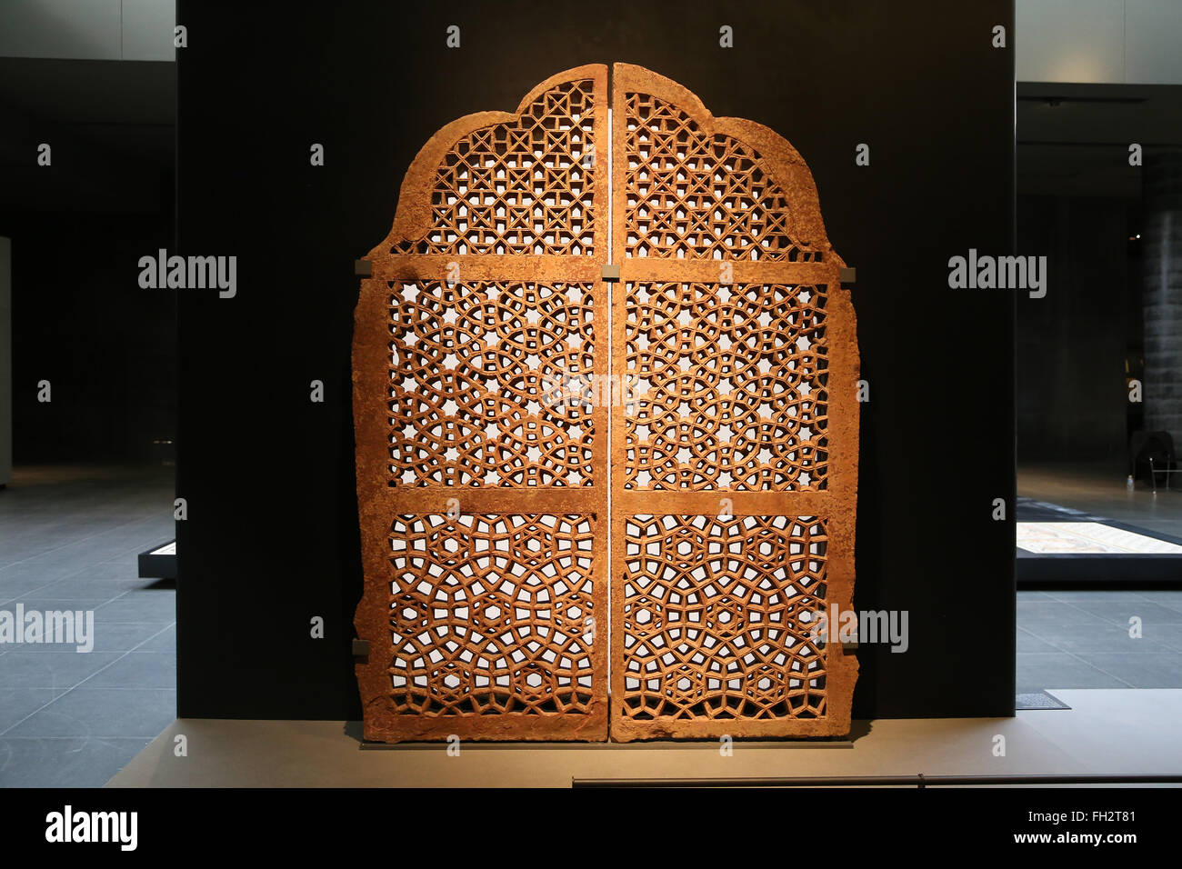 Window screen (jali). 16th-17th century. Indian. Red sandstone. Louvre Museum. - Stock Image