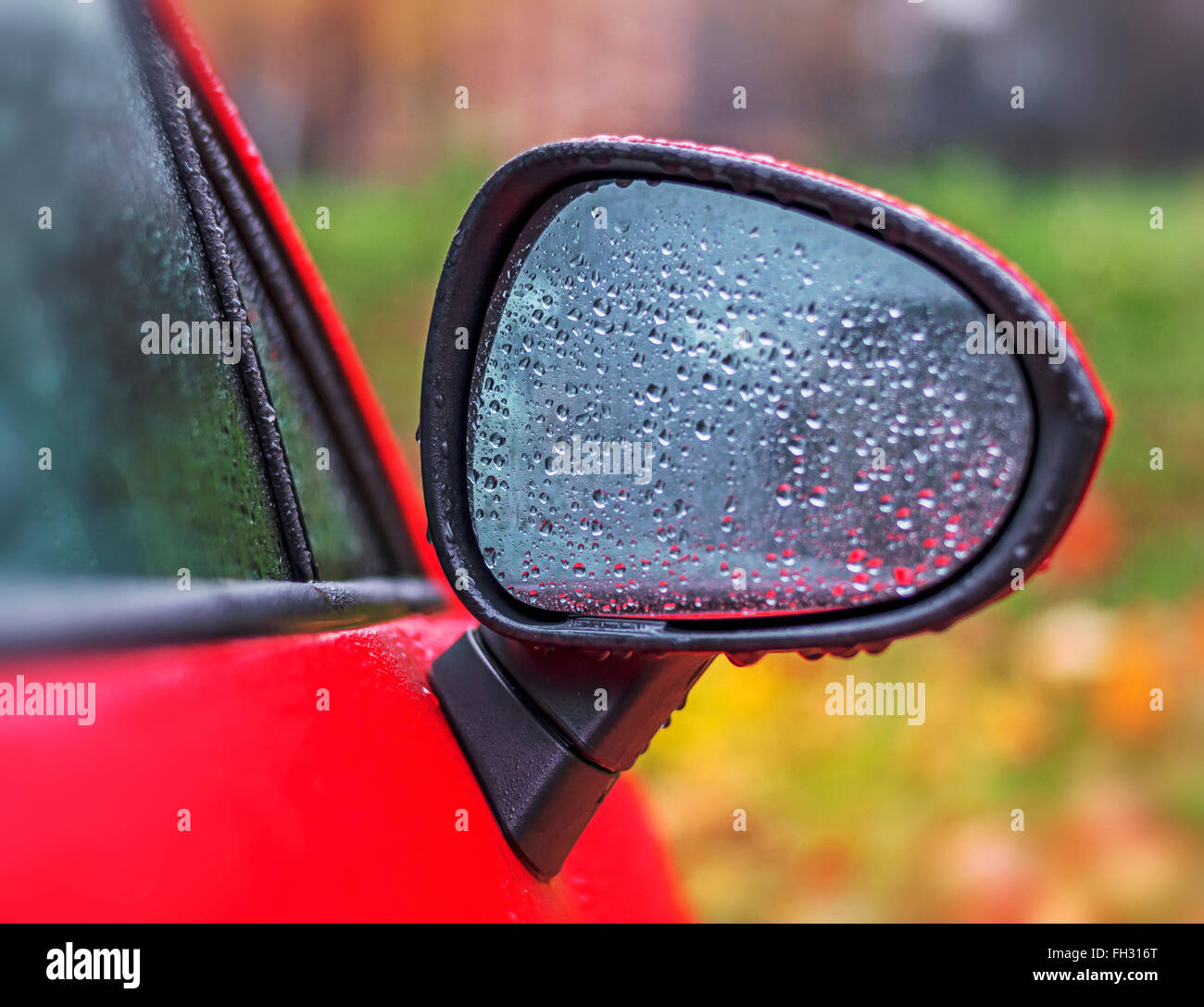 Outside car in the rain - Stock Image
