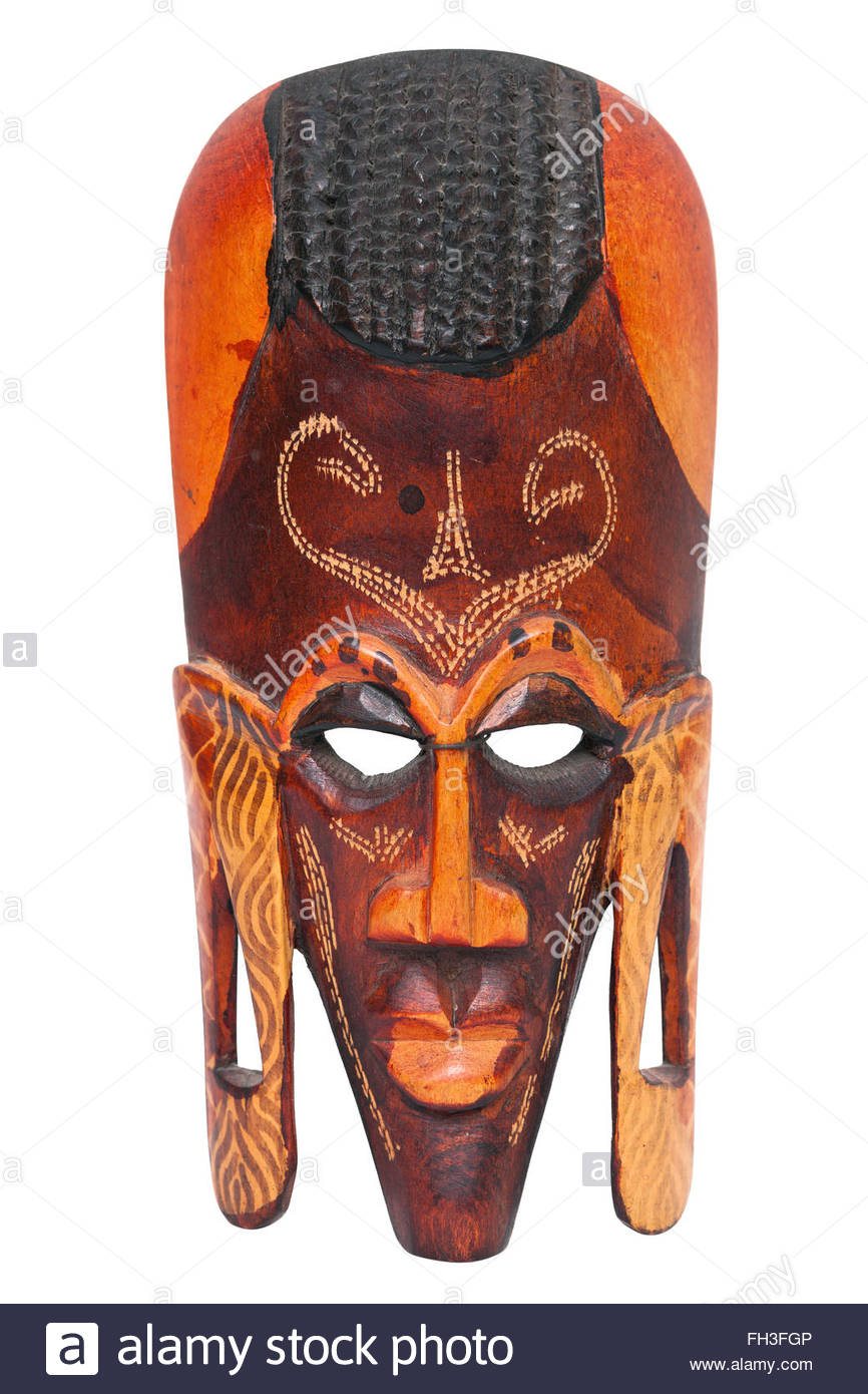 African hand carved wooden warrior Maasai mask. Used in traditional tribal ceremonies to scare their opponents. - Stock Image