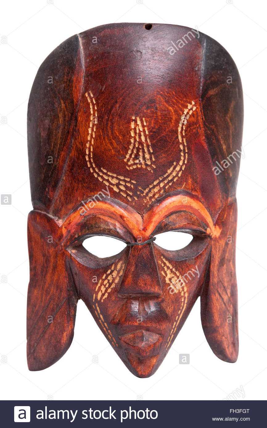 Small african hand carved wooden warrior Maasai mask. Used in traditional tribal ceremonies to scare their opponents. - Stock Image
