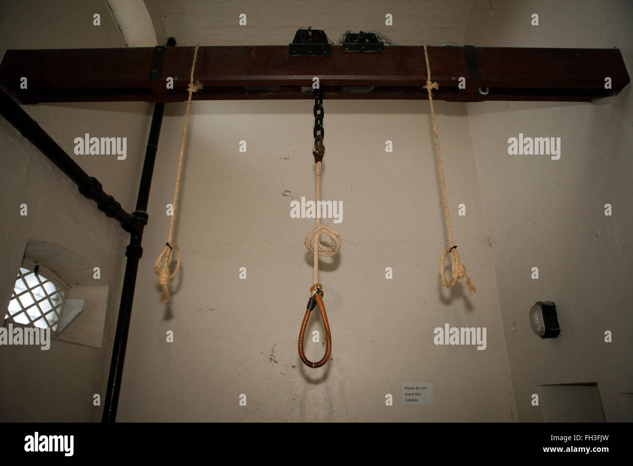 Belfast, UK. 21st February 2016. Hangmans Noose dangles from the original wooden beam in the execution room of the - Stock Image