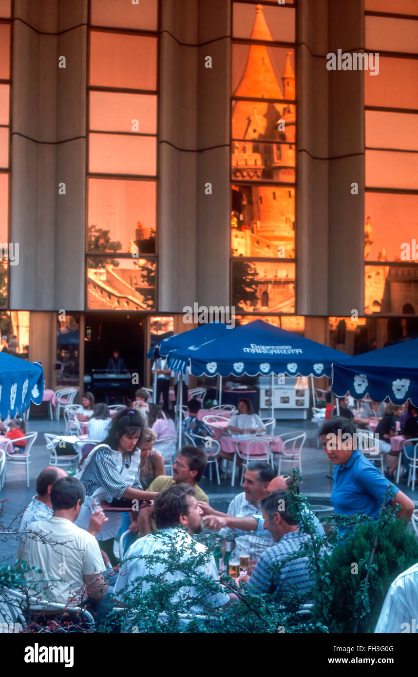 Budapest, Hungary - Hungarian Cafe Terrace, Crowd of Tourists Sharing Drinks, on Terrace at Hilton Hotel, Center Stock Photo