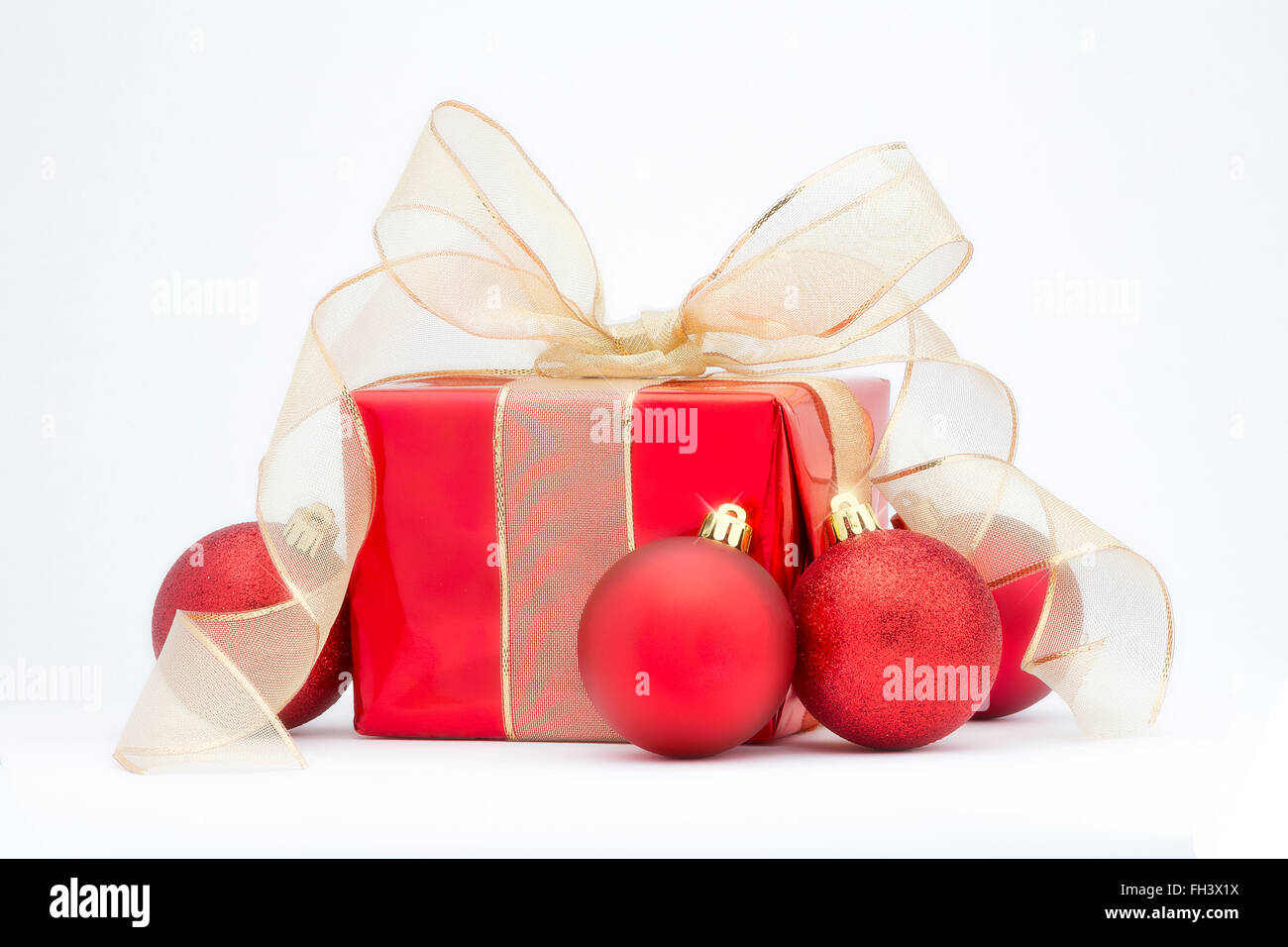Christmas Present Decoration.A Red Christmas Present With Gold Ribbon And Red Tree