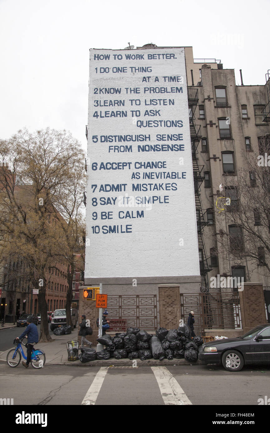 Building wall displays 10 ways to work better on Houston Street in the East Village, NYC. - Stock Image