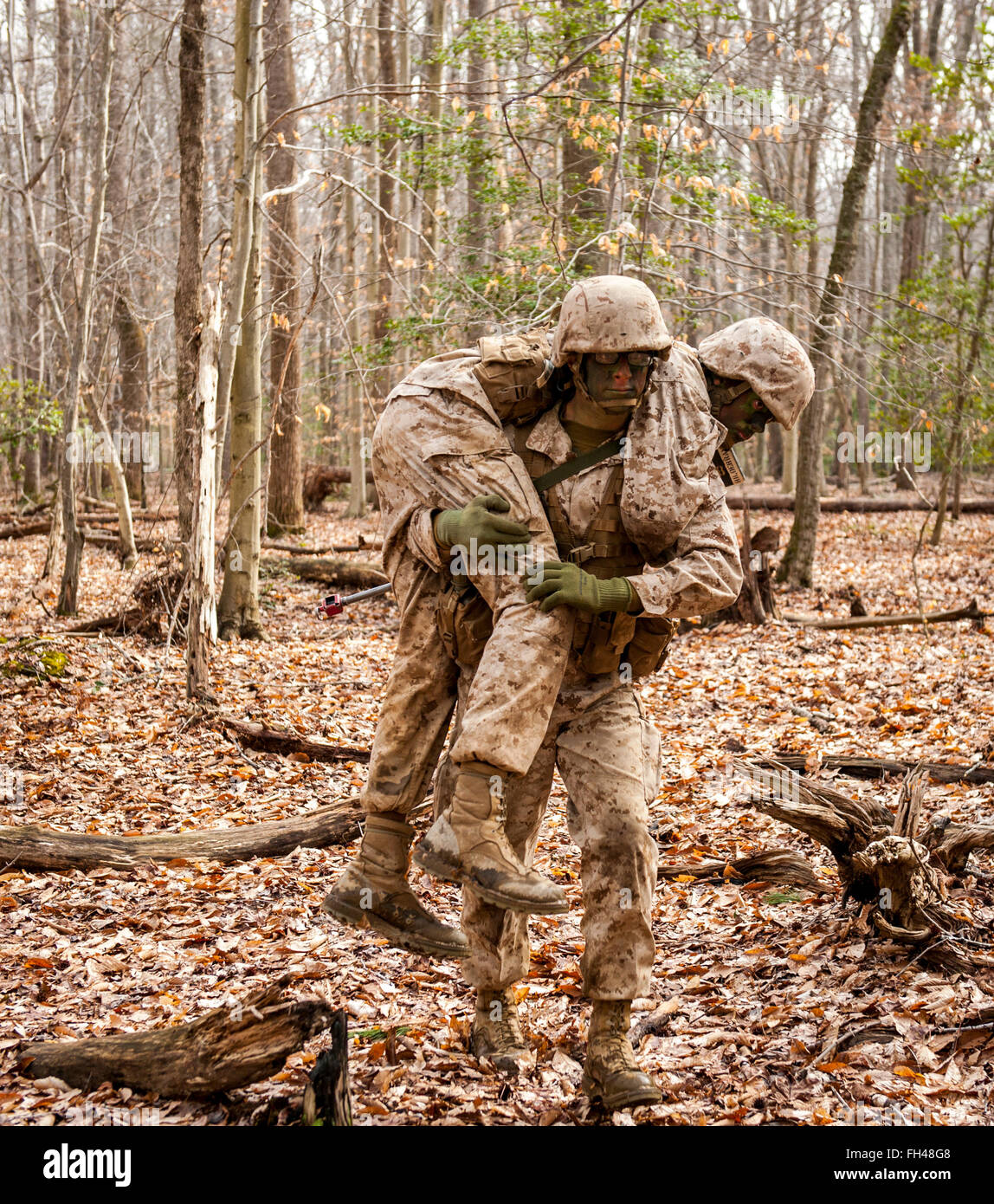 Candidates assigned to Delta Company, Officer Candidates Class-221, are evaluated as members of a fire team during Stock Photo